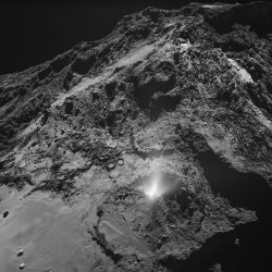 A plume of dust from Comet 67/P seen by the OSIRIS wide-angle camera on Rosetta. Image copyright: ESA/Rosetta/MPS for OSIRIS Team MPS/UPD/LAM/IAA/SSO/INTA/UPM/DASP/IDA