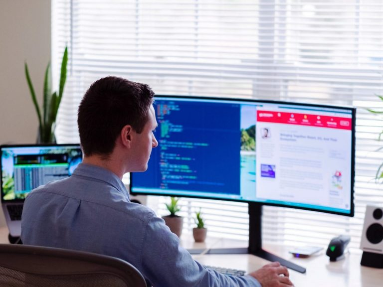 Man working remotely at a computer using MDR-Remote