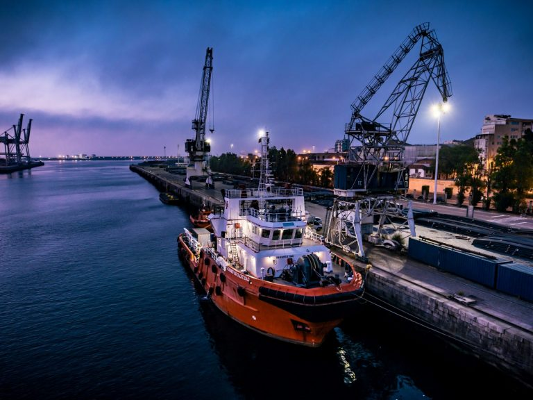 RHEA Group cargo boat docked at port in Portugal